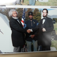 Radcliffe with the living history figures of black abolitionist Frederick Douglas, and Civil War president Abraham Lincoln.