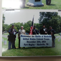 Photo with banner honoring veterans of the United States Colored Troops of the annual Battle of Nashville Memorial Service held at the Nashville National Cemetery.
